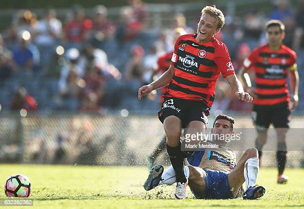 Lachlan Scott of the Wanderers is tackled during the round 16 ALeague match between the Western Sydney Wanderers and the Newcastle Jets at...