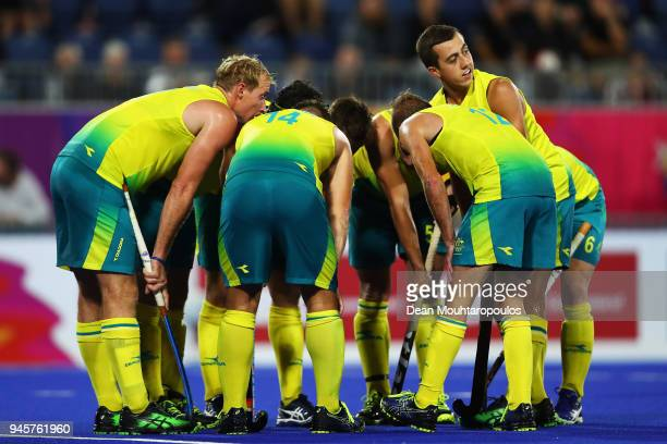 Lachlan Sharp of Australia listens to the penalty corner strategy during Men's Semifinal match between Australia and England on day nine of the Gold...
