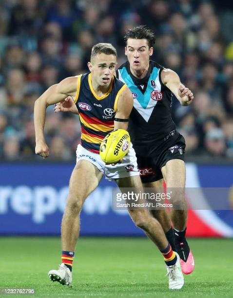 Lachlan Sholl of the Crows and Connor Rozee of the Power during the 2021 AFL Round 08 match between the Port Adelaide Power and the Adelaide Crows at...