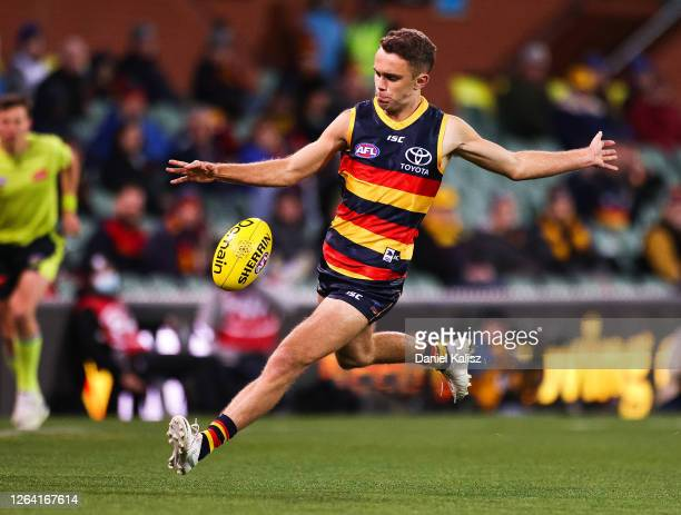 Lachlan Sholl of the Crows kicks the ball during the round 10 AFL match between the Adelaide Crows and the Melbourne Demons at Adelaide Oval on...