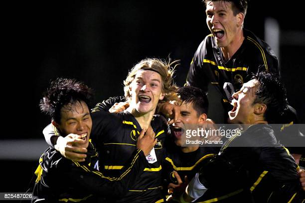 Lachlan Strogusz of Moreton Bay celebrates with team mates after scoring a goal during the FFA Cup round of 32 match between Moreton Bay United FC...