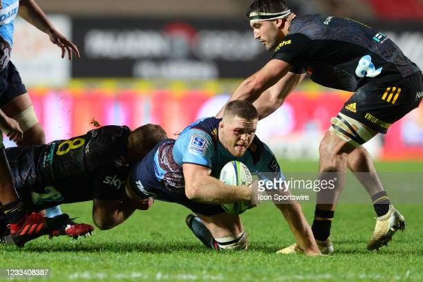 Lachlan Swinton of the Waratahs is tackled during the round five Super Rugby Trans Tasman match between the NSW Waratahs and Chiefs at Brookvale Oval...