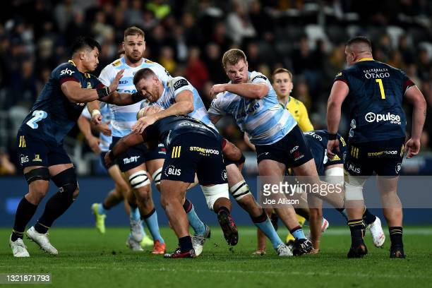 Lachlan Swinton of the Waratahs runs into the defence during the round four Super Rugby Trans-Tasman match between the Highlanders and the NSW...
