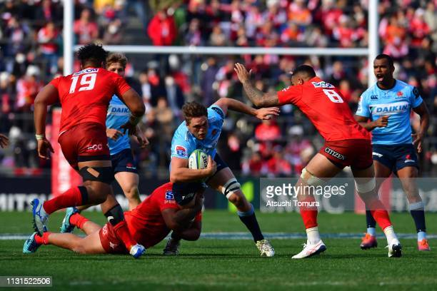 Lachlan Swinton of Waratahs is tackled during the Super Rugby match between Sunwolves and Waratahs at the Prince Chichibu Memorial Ground on February...