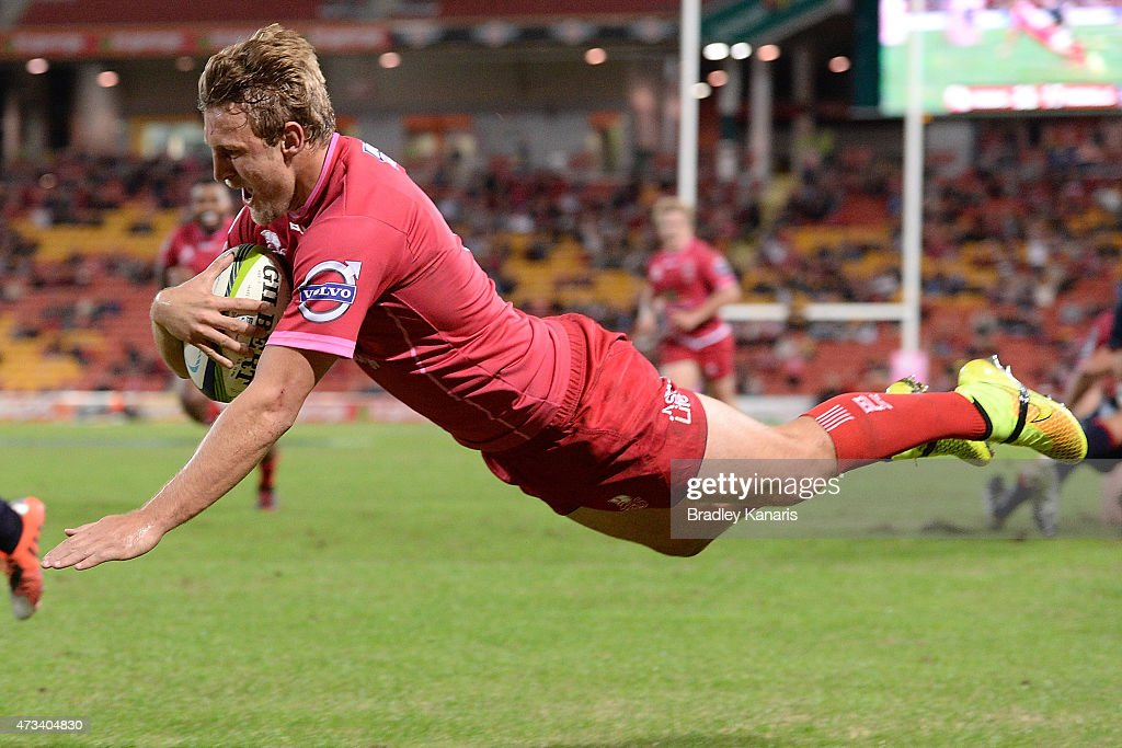 Lachlan Turner of the Reds dives over to score a try during the round 14 Super Rugby match between the Queensland Reds and the Melbourne Rebels at Suncorp Stadium on May 15, 2015 in Brisbane, Australia.
