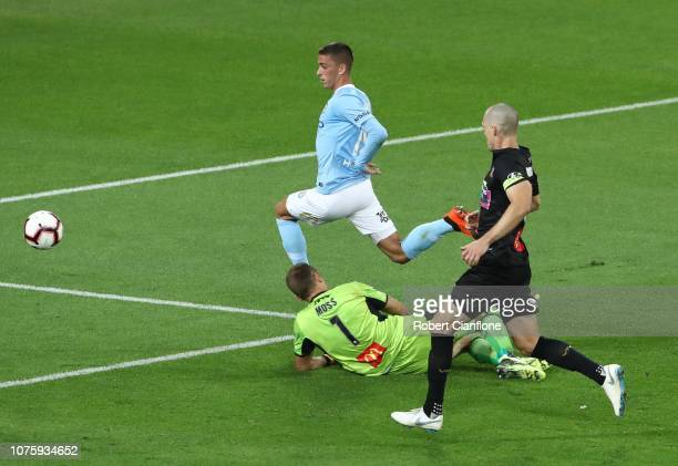 Lachlan Wales of Melbourne City gets his shot past Newcastle Jets goalkeeper Glen Moss to score during the round six A-League match between Melbourne...