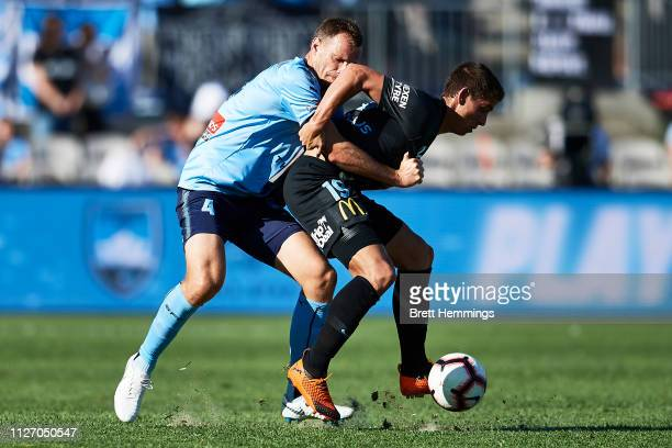 Lachlan Wales of Melbourne City is tackled by Alexander Wilkinson of Sydney during the round 17 ALeague match between Sydney FC and Melbourne City at...