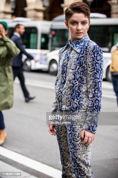 Lachlan Watson wearing a blue and cream snake print jacket with matching pants is seen outside the Giambattista Valli show during Paris Fashion Week...