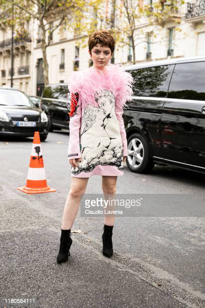 Lachlan Watson wearing a pink decorated dress and black boots is seen outside the Valentino show during Paris Fashion Week Womenswear Spring Summer...