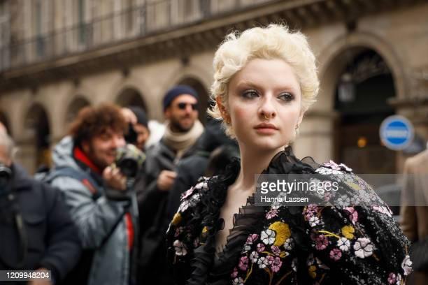 Lachlan Watson wearing floral spangled dress outside Giambattista Valli during Paris Fashion Week Womenswear Fall/Winter 2020/2021 Day Eight on March...