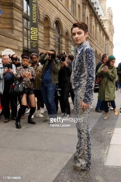 Lachlan Watson wearing Giambattista Valli outside Giambattista Valli during Paris Fashion Week Womenswear Spring Summer 2020 on September 30 2019 in...