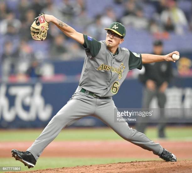 Lachlan Wells of Australia's World Baseball Classic team delivers a pitch in the fifth inning of an exhibition game against the Hanshin Tigers at...