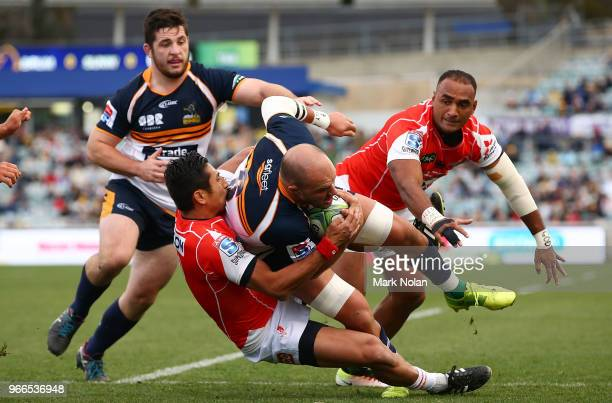 Lachy McCaffrey of the Brumbies is tackled during the round 16 Super Rugby match between the Brumbies and the Sunwolves at GIO Stadium Stadium on...