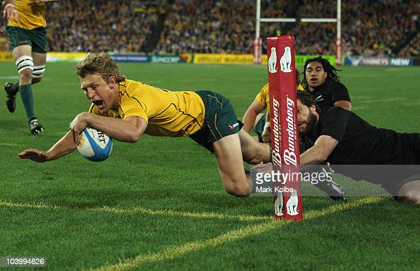 Lachy Turner of the Wallabies dives over for try whiuch was later disallowedduring the 2010 TriNations Bledisloe Cup match between the Australian...