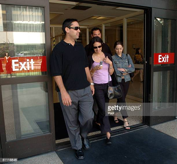 Laci Peterson's brother Brent Rocha Brent's wife Rose Marie Rocha and Laci's sister Amy Rocha leave the San Mateo County Courthouse July 26 2004 in...