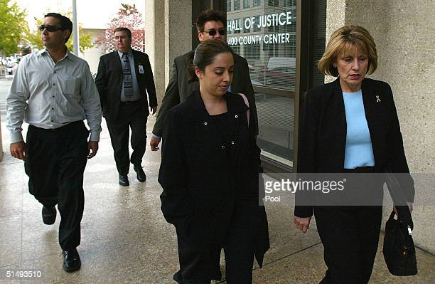 Laci Peterson's family members brother Brent Rocha sister Amy Rocha and mother Sharon Rocha enter the San Mateo Superior Courthouse after the lunch...