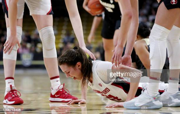 Lacie Hull of the Stanford Cardinal picks herself off the court after being fouled during the fourth quarter of a game between the Stanford Cardinal...