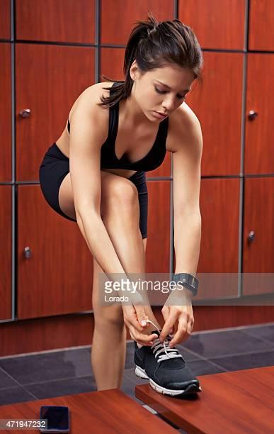 lacing shoe woman in locker room