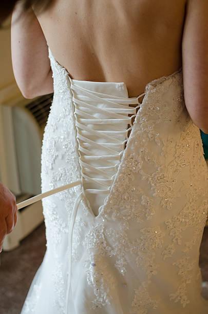 Lacing up a Corset Back Wedding Dress | Photos.com