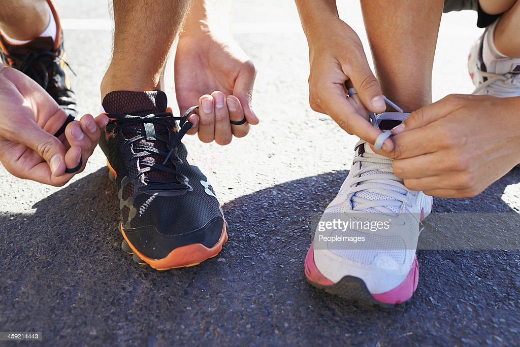 Lacing up before the run : Stock Photo