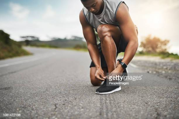 lacing up to get into top form - black shoe stock pictures, royalty-free photos & images