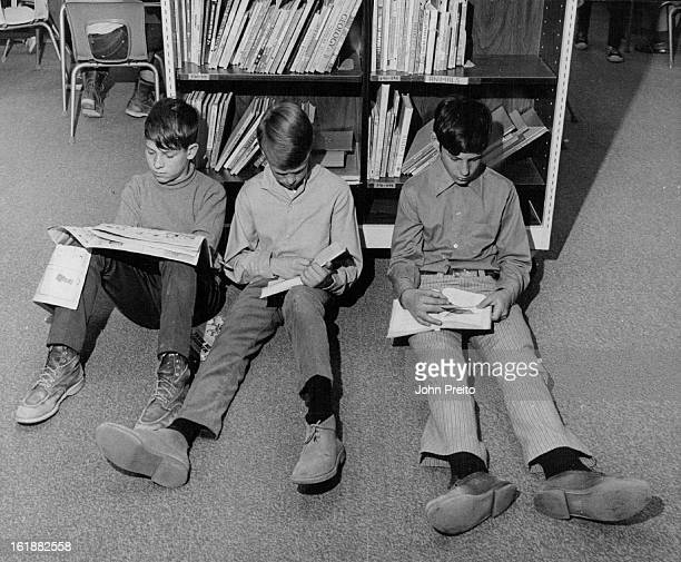 JAN 22 1970 FEB 6 1970 FEB 11 1970 Lack of seating at Virginia Court Elementary School 385 S Troy St Aurora forces these sixth grade students to use...