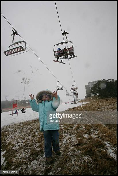 Lack of snow at Mt Buller hasn't kept people away from the slopes however very few runs are open Twoyearold Maeve enjoys what little snow there is 23...