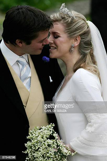 Groom Harry Lopes and Bride Laura ParkerBowles daughter of Camilla ParkerBowles Duchess of Cornwall kiss as they leave Lacock Cyriac's Church after...