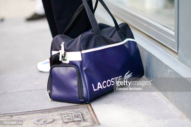 Lacoste bag is seen outside Thom Browne during Paris Fashion Week Menswear SpringSummer 2019 on June 23 2018 in Paris France
