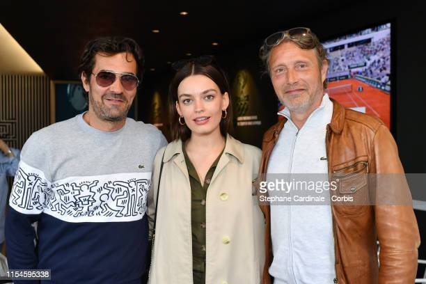 Lacoste CEO Thierry Guibert actors Emma Mackey and Mads Mikkelsen attend the 2019 French Tennis Open Day Fourteen at Roland Garros on June 08 2019 in...