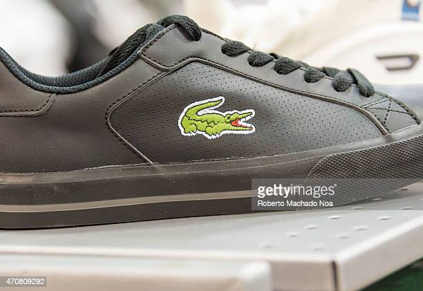 Lacoste Shoe in a store shelf Lacoste is a French clothing company founded in 1933 that sells highend clothing footwear perfume leather goods watches...