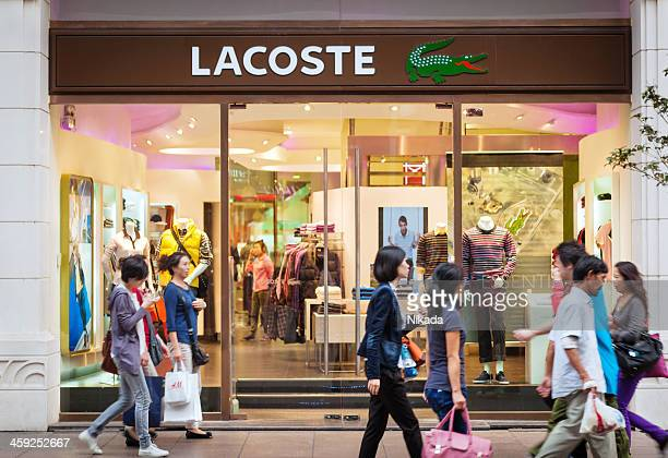 lacoste store in shanghai, china - lacoste designer label stock pictures, royalty-free photos & images