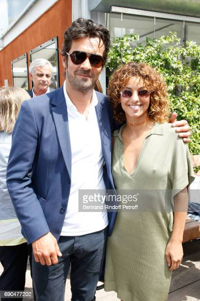 CEO Lacoste Thierry Guibert and Singer Tal Benyerzi aka Tal attend the 2017 French Tennis Open Day Four at Roland Garros on May 31 2017 in Paris...