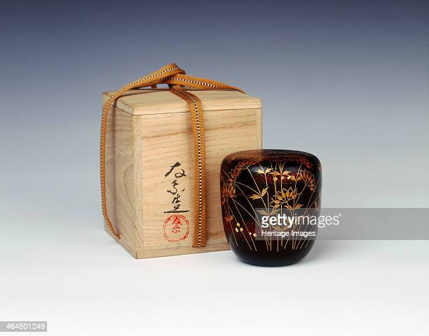 Lacquer natsume with original box signed 'Ujo Gota', 1970-1979. An unsigned circular natsume container decorated on a shiny black lacquer background...
