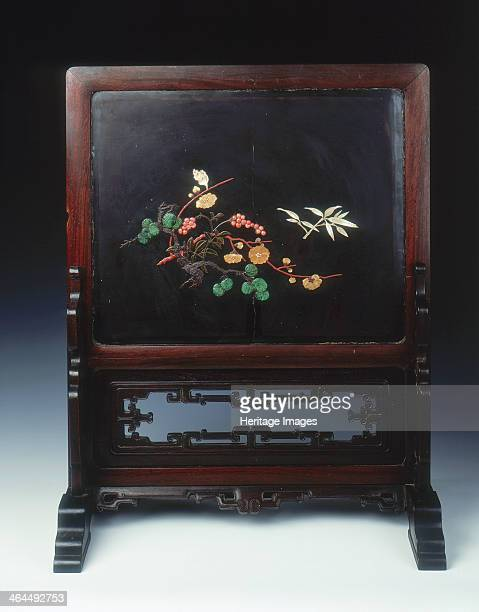 Lacquer plaque mounted as a screen with various inlays Qing dynasty China 1st half 18th century A black lacquer inlaid plaque mounted as a screen One...