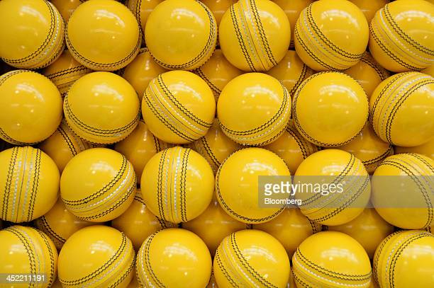 Lacquered yellow cricket balls await labeling at the Kookaburra Sports Pty Ltd plant in Melbourne Australia on Tuesday Nov 26 2013 Australian...