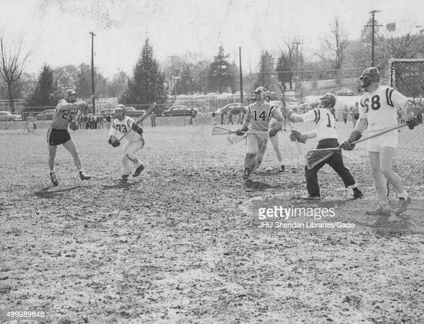 Lacrosse Alfred Lester Seivold Edward Bernstein Game against University of Virginia in progress Seivold firing goal as Bernstein looks on 1959