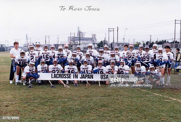 Lacrosse Japanese lacrosse team in Tokyo grouped behind banner reading 'Lacrosse in Japan USA vs Japan The First Game Ever in Japan' 1987