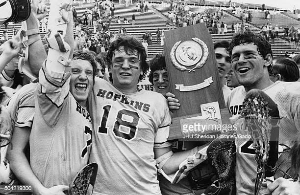 Lacrosse Members of team holding trophy of Lacrosse Championships 1978