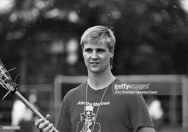 Lacrosse Nils Youngwall Candid photograph Youngwall demonstrating lacrosse techniques to Japanese exchange group 1988