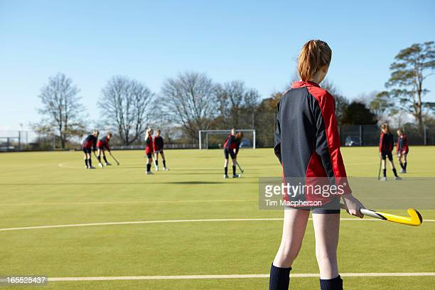 lacrosse player standing in game - field hockey stock pictures, royalty-free photos & images