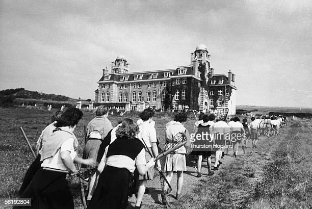 Lacrosse players at Roedean public school for girls in Sussex return to the college after a match 13th October 1951 Picture Post The Yanks At Roedean...