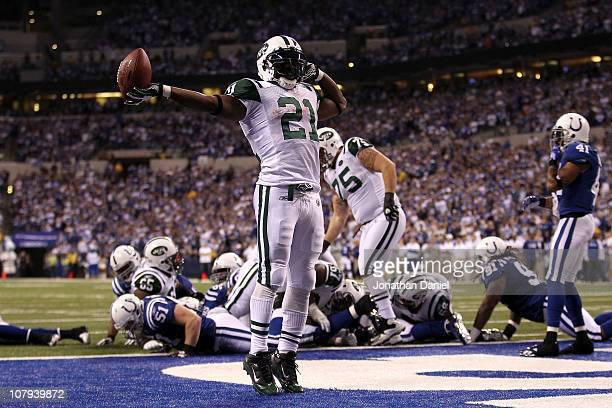 LaDainian Tomlinson of the New York Jets celebrates after he scored a 1-yard touchdown in the fourth quarter against the Indianapolis Colts during...