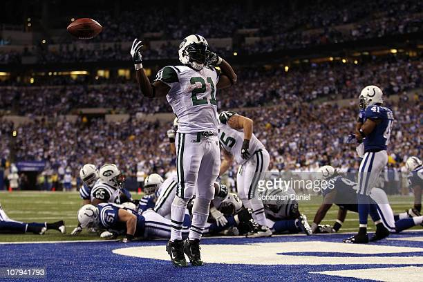 LaDainian Tomlinson of the New York Jets celebrates after he scored a 1yard rushing touchdown in the fourth quarter against the Indianapolis Colts...