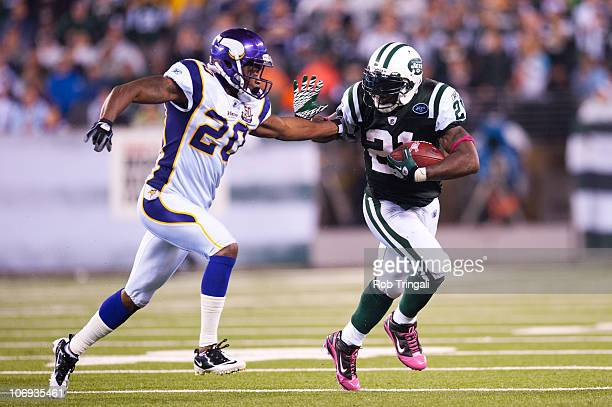 LaDainian Tomlinson of the New York Jets rushes against Madieu Williams and the Minnesota Vikings on October 11 2010 at the New Meadowlands Stadium...