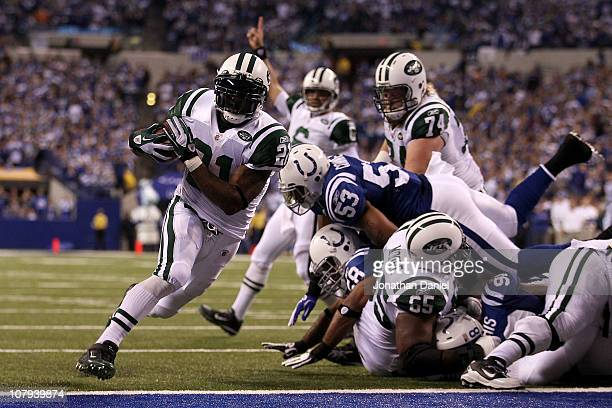 LaDainian Tomlinson of the New York Jets scores 1-yard rushing touchdown in the fourth quarter as quarterback Mark Sanchez celebrates in the...