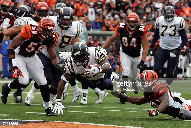 LaDainian Tomlinson of the San Diego Chargers dives for a touchdown in front of Tory James and Landon Johnson of Cincinnati Bengals on November 12,...