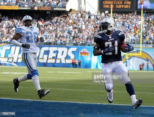 LaDainian Tomlinson of the San Diego Chargers scores a touchdown in front of Kenoy Kennedy of the Detroit Lions during the first quarter at Qualcomm...