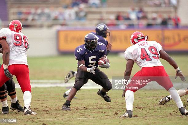 LaDainian Tomlinson of the Texas Christian University carries the ball as he avoids Orlando Huff of Fresno State during a game at Amon Carter Stadium...
