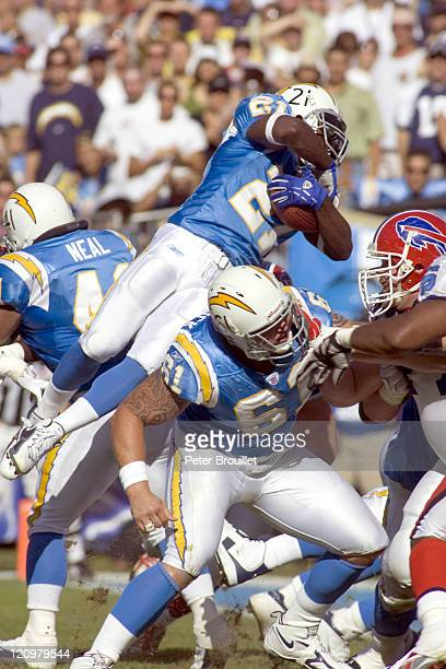 LaDainian Tomlinson running back for the San Diego Chargers leaps over the line of scrimmage for a short gain in a game against the Buffalo Bills at...